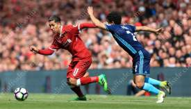 Roberto Firmino of Liverpool battles with Fabio of Middlesbrough
