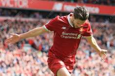 Adam Lallana of Liverpool celebrates after scoring their 3rd goal