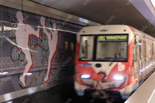 A metro train arrives at Spartak station