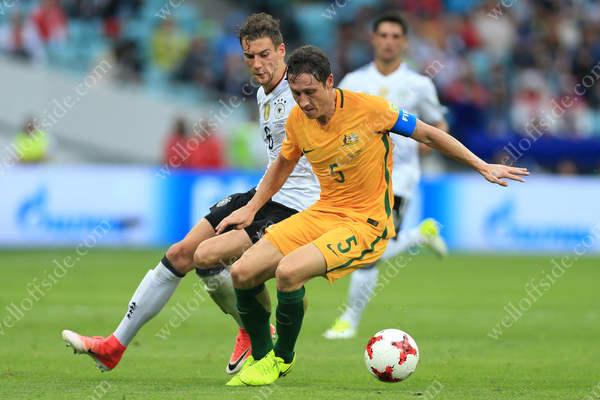 Mark Milligan of Australia battles with Leon Goretzka of Germany