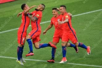 Martin Rodriguez of Chile (L) celebrates with teammates Arturo Vidal (2L), Alexis Sanchez (2R) and Eduardo Vargas (R) after scoring their 1st goal