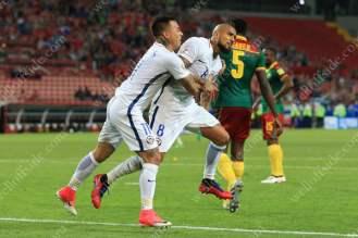 Arturo Vidal of Chile (R) celebrates with teammate Eduardo Vargas after scoring their 1st goal