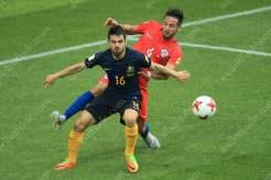 Aziz Behich of Australia battles with Mauricio Isla of Chile