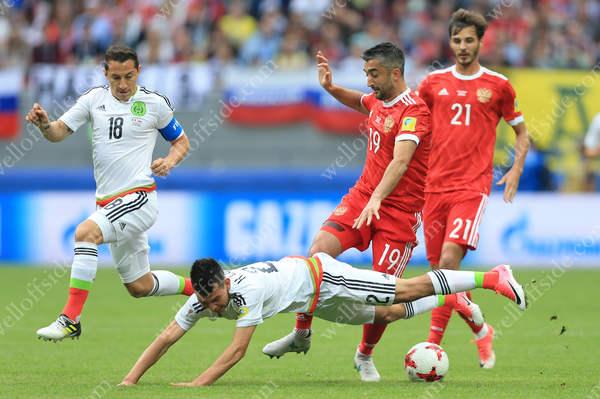 Aleksandr Samedov of Russia fouls Hirving Lozano of Mexico