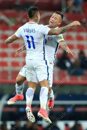 Eduardo Vargas of Chile (L) celebrates with teammate Leonardo Valencia after scoring their 2nd goal