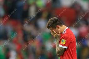 Fedor Smolov of Russia (R) cries as his side are eliminated from their own tournament