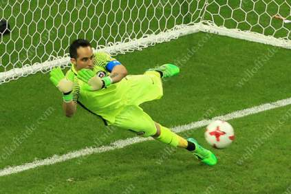 Chile goalkeeper Claudio Bravo saves a penalty during the shoot-out