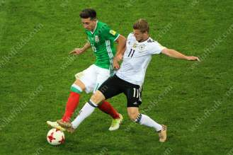 Timo Werner of Germany battles with Hector Herrera of Mexico
