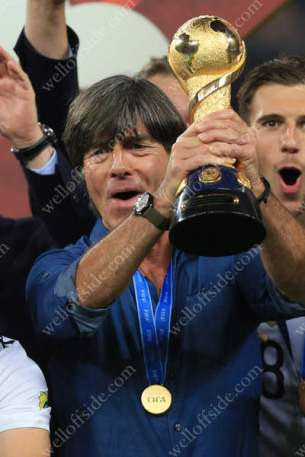 Germany coach Joachim Low lifts the trophy