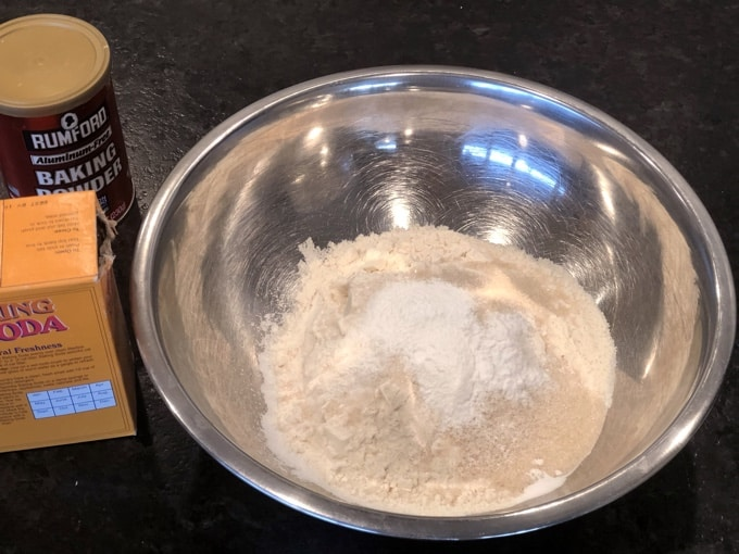 Flour, sugar, baking powder, baking soda and salt in mixing bowl