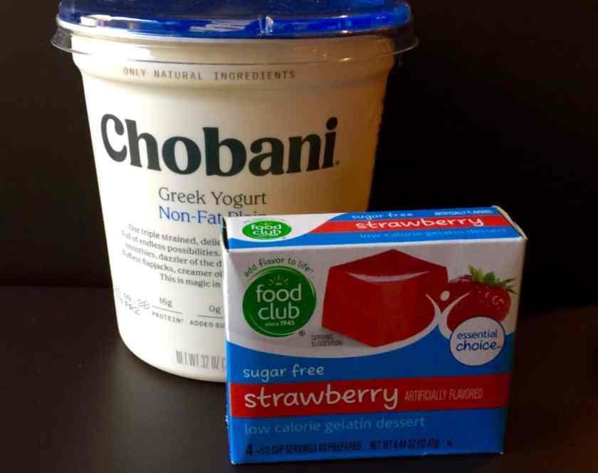 Container of Chobani Greek non-fat plain yogurt with box of sugar-free strawberry gelatin.