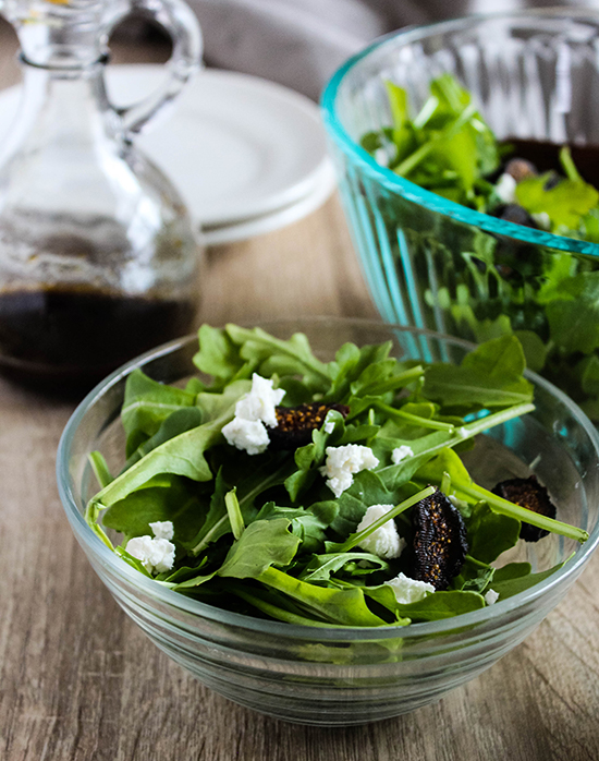Arugula salad made with figs goat cheese and almonds