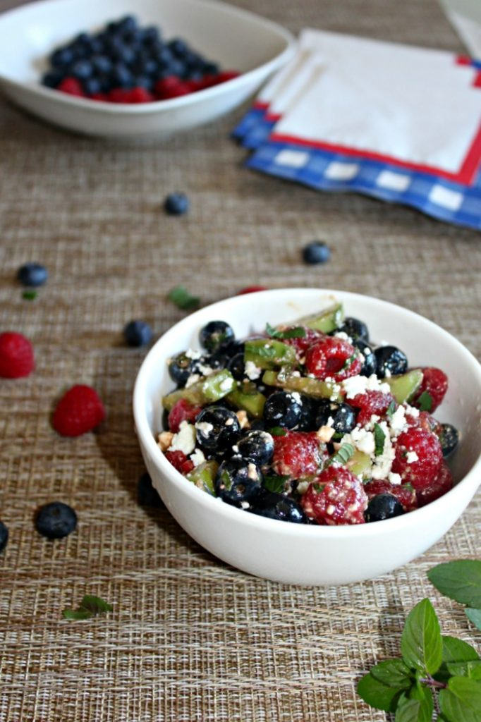 Red white and blue salad made with blueberries, raspberries and cucumbers