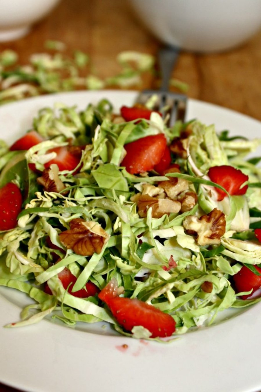Shaved Brussels Sprouts Salad with walnuts and strawberries