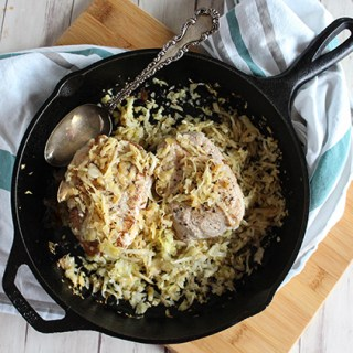 Pork Chops with apples and sauerkraut in a skillet simple and savory