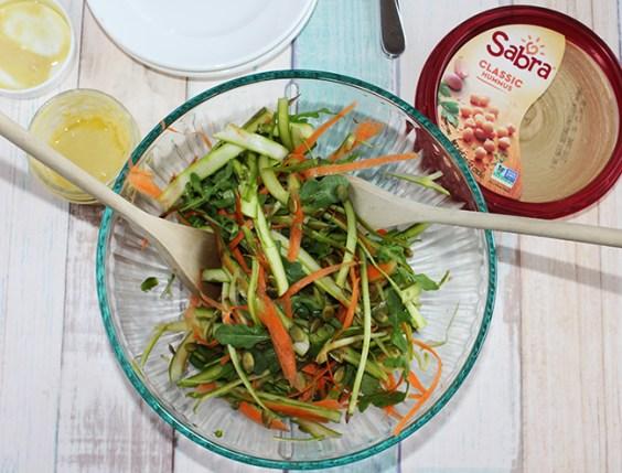 shaved asparagus salad in a bowl overhead shot