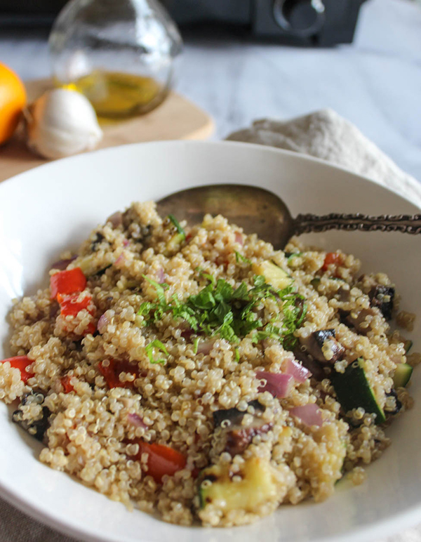 A close up view of grilled vegetable quinoa salad