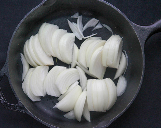 Raw onions in a pan