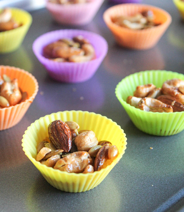 a close up of cashew clusters in a yelow cupcake liner