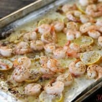 Only 4 ingredients and a few minutes in the oven and you've got dinner ready! Buttery Baked Shrimp is a perfect weeknight meal.
