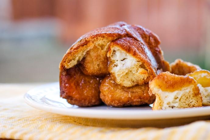 cream cheese stuffed monkey bread on a plate