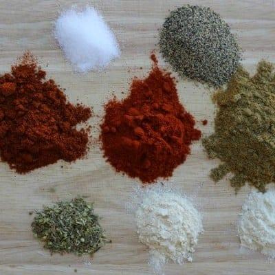 piles of seasonings used as ingredients for homemade mild taco seasoning mix