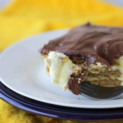 This S'mores Eclair Cake is an easy no bake dessert. It tastes just like an eclair or a Boston cream donut. Make it ahead for an easy potluck dessert!