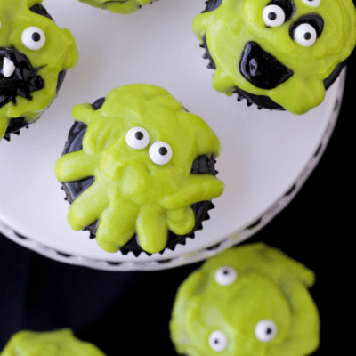 Add some ooze to your Halloween table this year with easy Slime Monster Cupcakes! They are slime-filled for a delicious gooey bite!