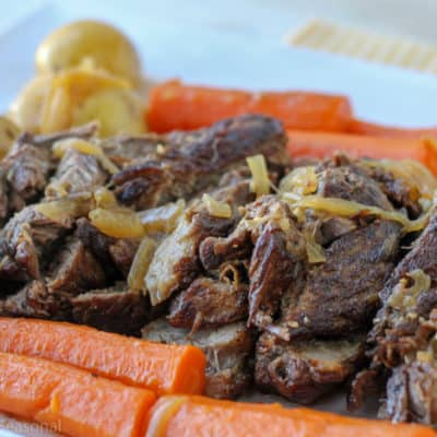 Crockpot Express Pot Roast is a classic meal cooked in a new way that cuts down on cook time and infuses the meat with so much flavor!