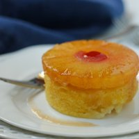 closeup of cake with pineapple ring on top