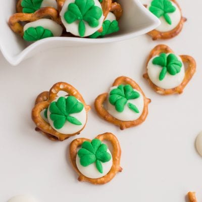 close up of pretzels with with green shamrocks