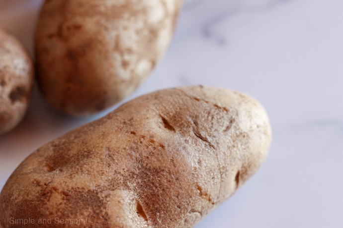closeup of potato with puncture marks from a fork