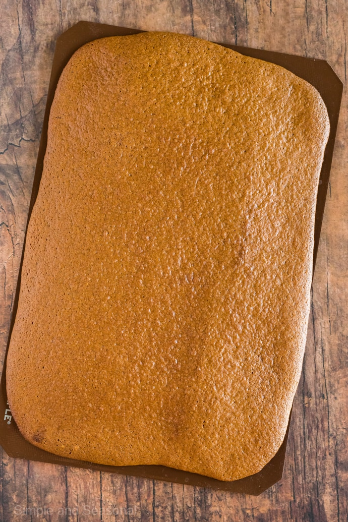 cooked pumpkin roll sheet on silicone mat
