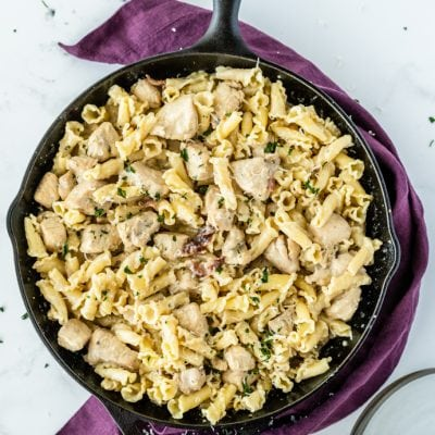 cooked pasta in skillet with meat and sauce