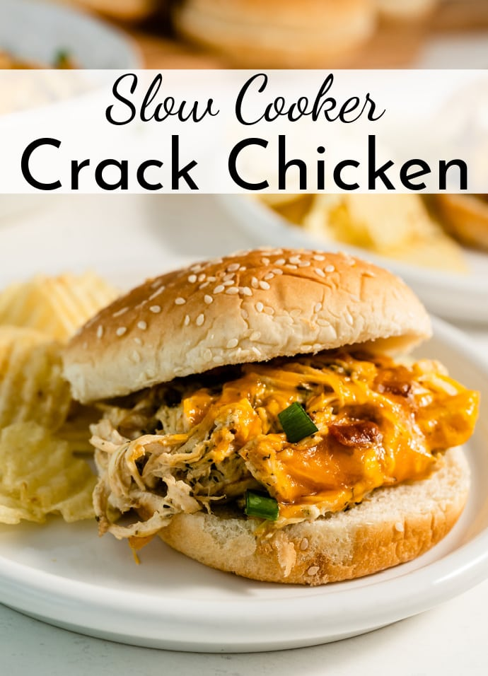 hamburger bun stuffed with slow cooker crack chicken on a plate with chips