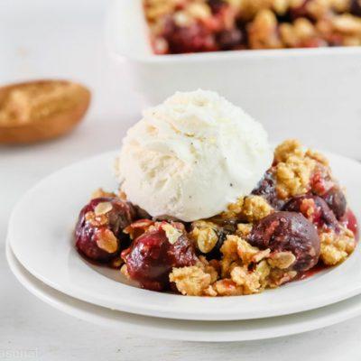 cherry crumble topped with vanilla ice cream