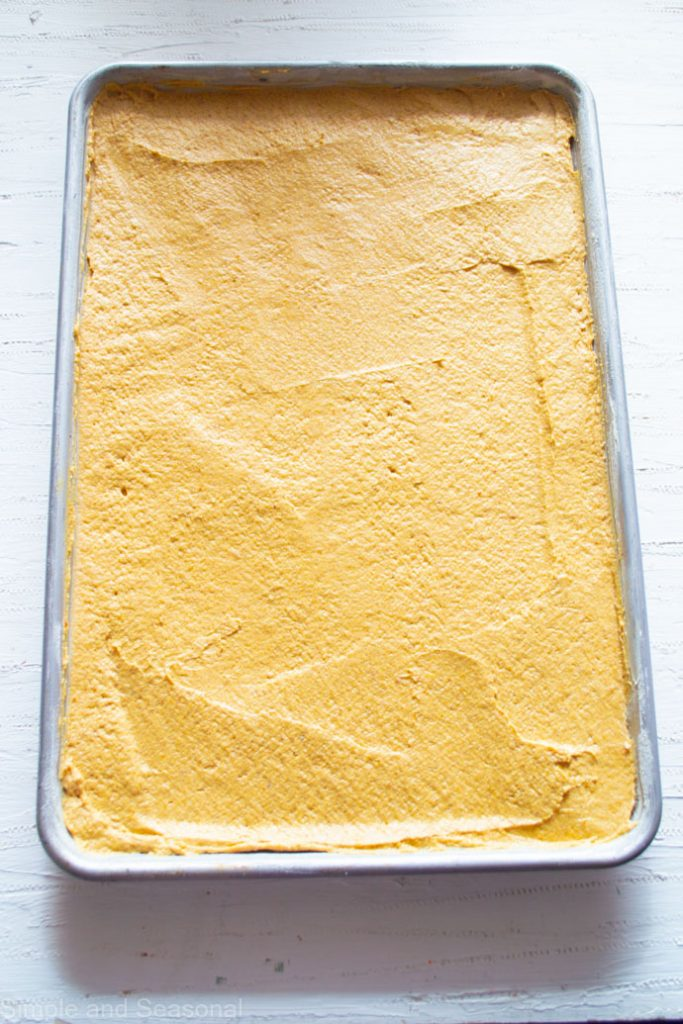 top down view of batter in a sheet cake pan