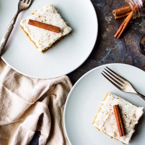 two plates with slices of pumpkin sheet cake on them