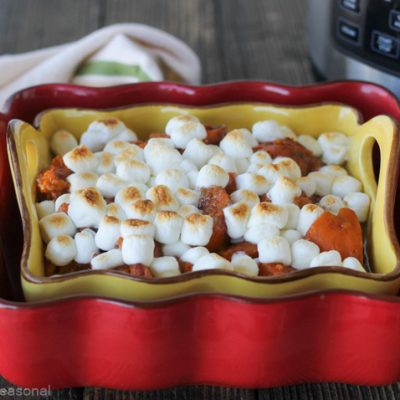 red and yellow dish with cooked Crockpot Express Candied Yams