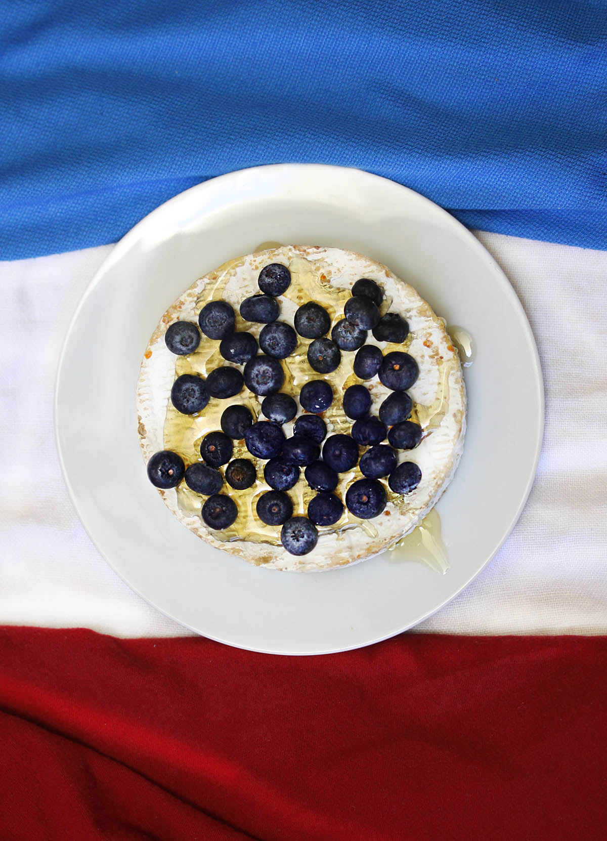 Baked French Brie Cheese with Honey and Blueberries