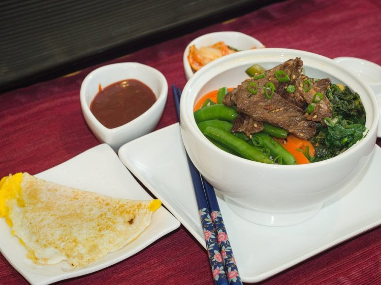 Bi-Bim-Bap with Beef Bulgogi, served with kimchi, egg and a spicy sauce