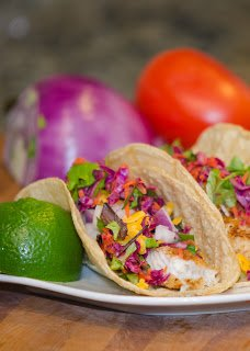 Tilapia Fish Tacos with Cabbage, Cheese, Avocado and Lime