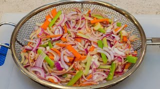 Peppers, Onions and Carrots in a Wire Grill Basket