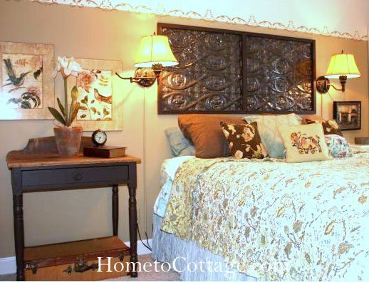 HometoCottage.com antique tin tile used as headboard in former house