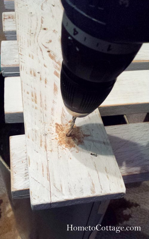 HometoCottage.com pre drilling holes for the screws