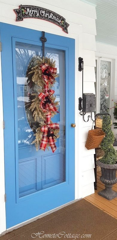 HometoCottage.com door with banner and tree