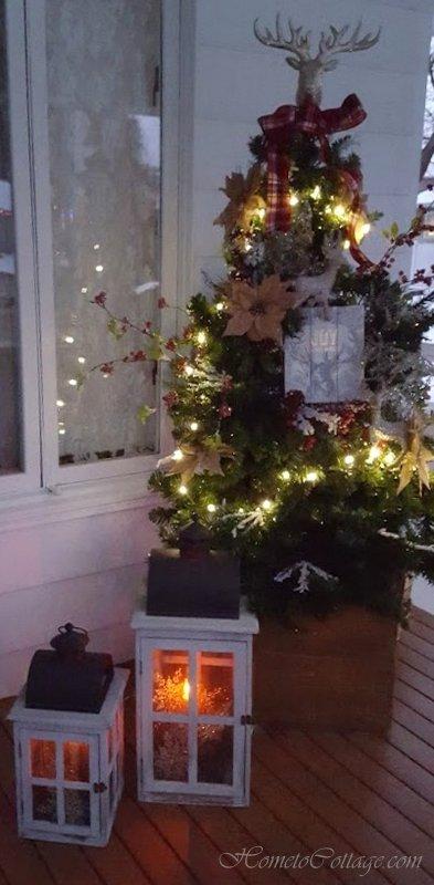 HometoCottage.com tree lit and lanterns glowing