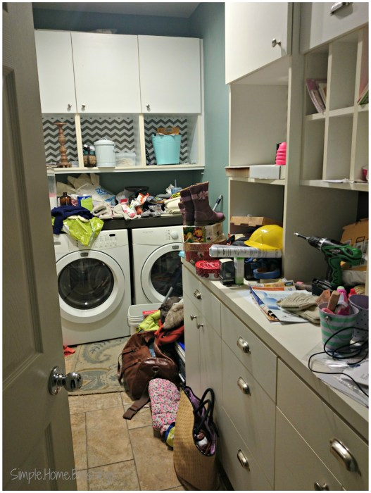 a peek at our clutter filled laundry room