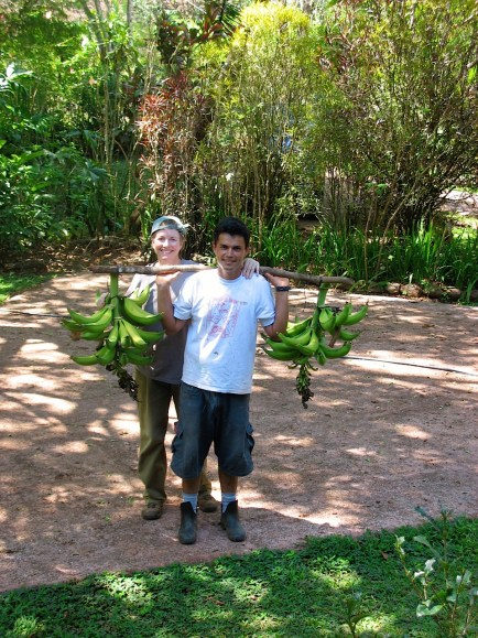 Cis Wilson, owner of Refugio de Los Angeles, and Jesus pose with Jesus' quick, post lunch, harvest of plantains,