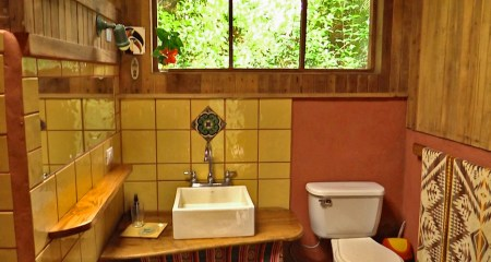 Photograph of the sink and toilet in the guest house bathroom.